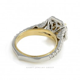 GIA Certified 2.0ct. Yellow Diamond Halo Engagement Ring in Platinum and 22kt. Yellow Gold.